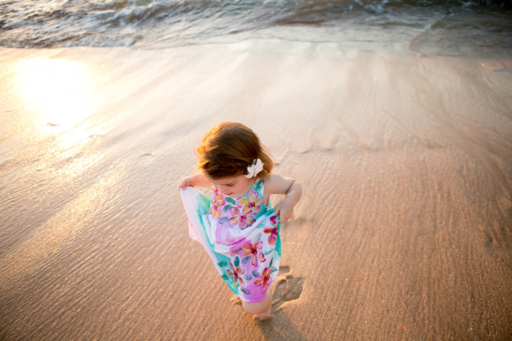 girl playing on the maui beach